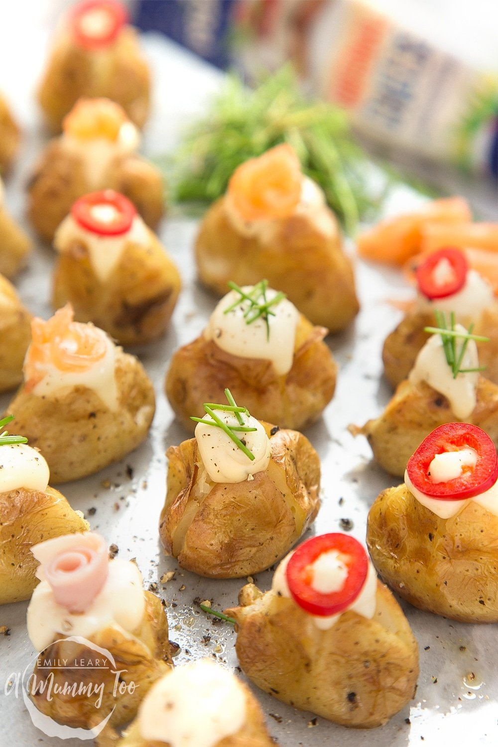 Close up of stuffed mini baked potatoes topped with Primula and toppings
