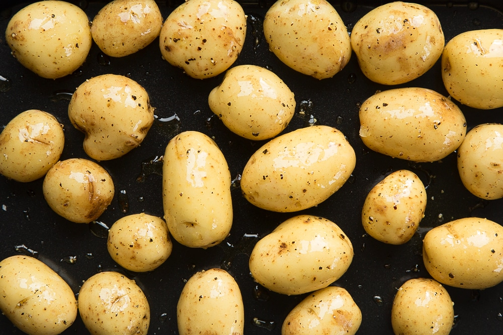 Mini potatoes drizzled with oil and a sprinkle of salt and pepper