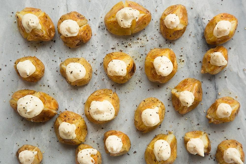 Season your stuffed mini baked potatoes with pepper