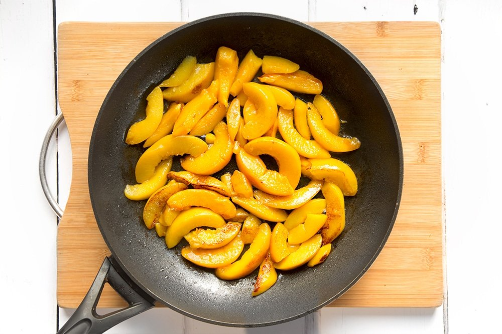 The peaches are warmed before being added to the cinnamon French toast