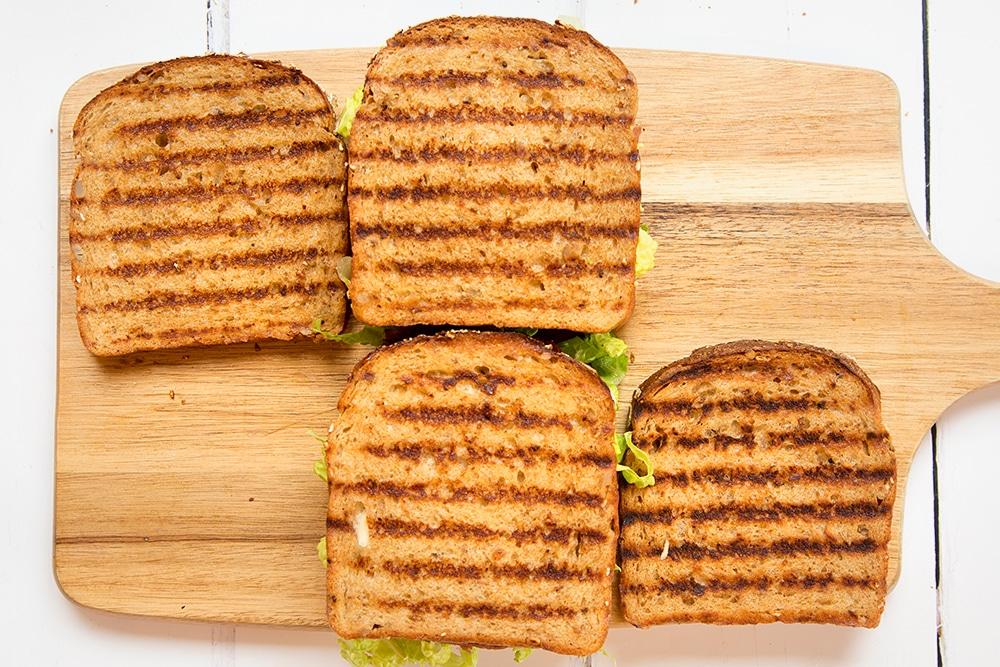 Assembling the deli-style corned beef on rye sandwich