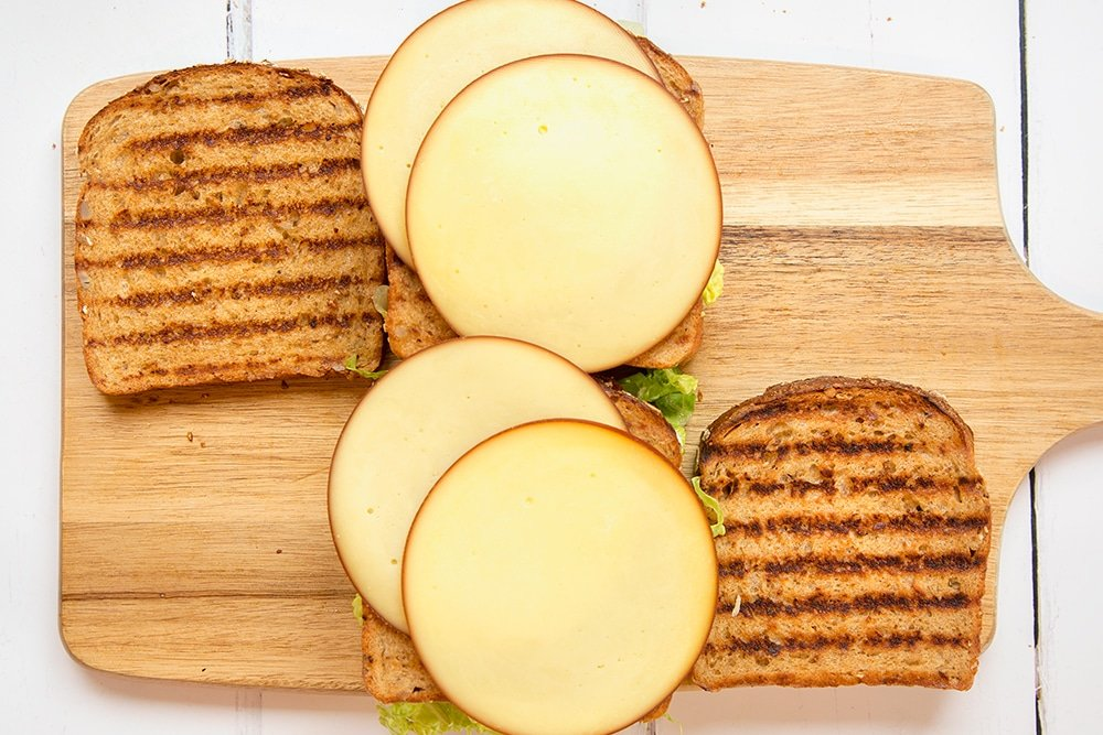Smoked cheese is layered into the sandwich