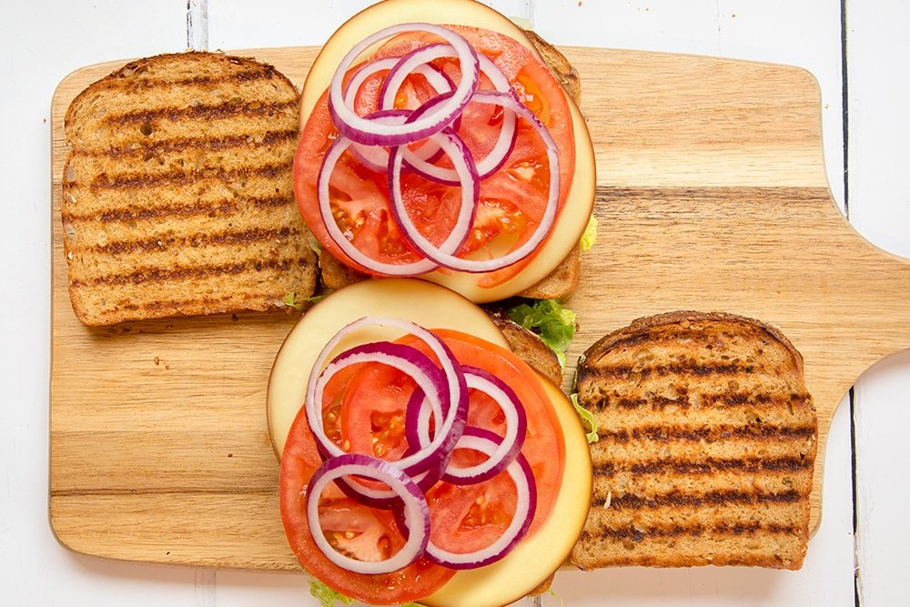 This deli-style corned beef on rye sandwich also features tomatoes and red onion