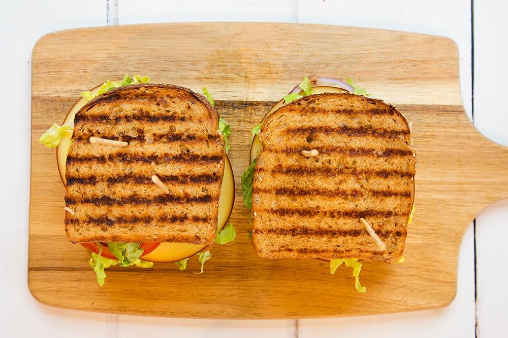 Skewered deli-style corned beef on rye sandwich