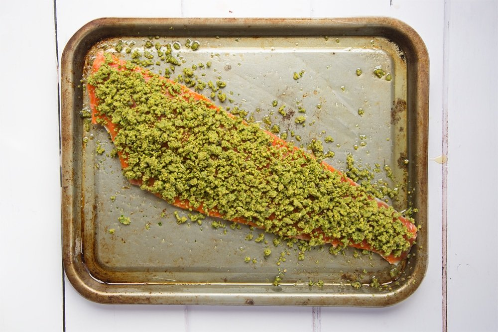 Prepare the Alaska salmon fillet by topping with the crumb