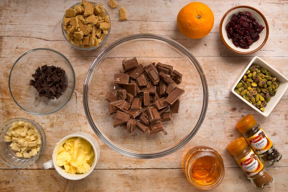 Ingredients for the Christmas spiced chocolate salami, shown in bowls alongside Schwartz spices
