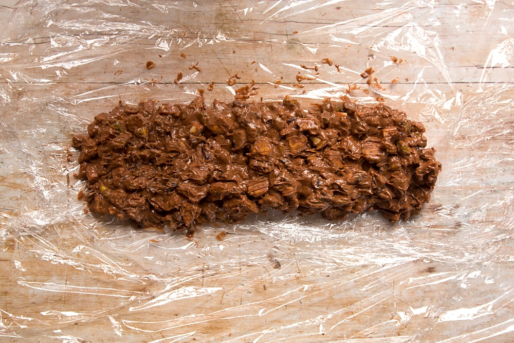 Lay the Christmas spiced chocolate salami mixture on top of cling film