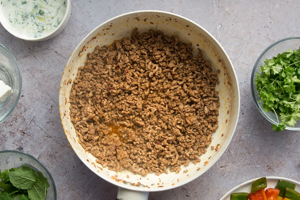Cook the lamb mince until it is browned