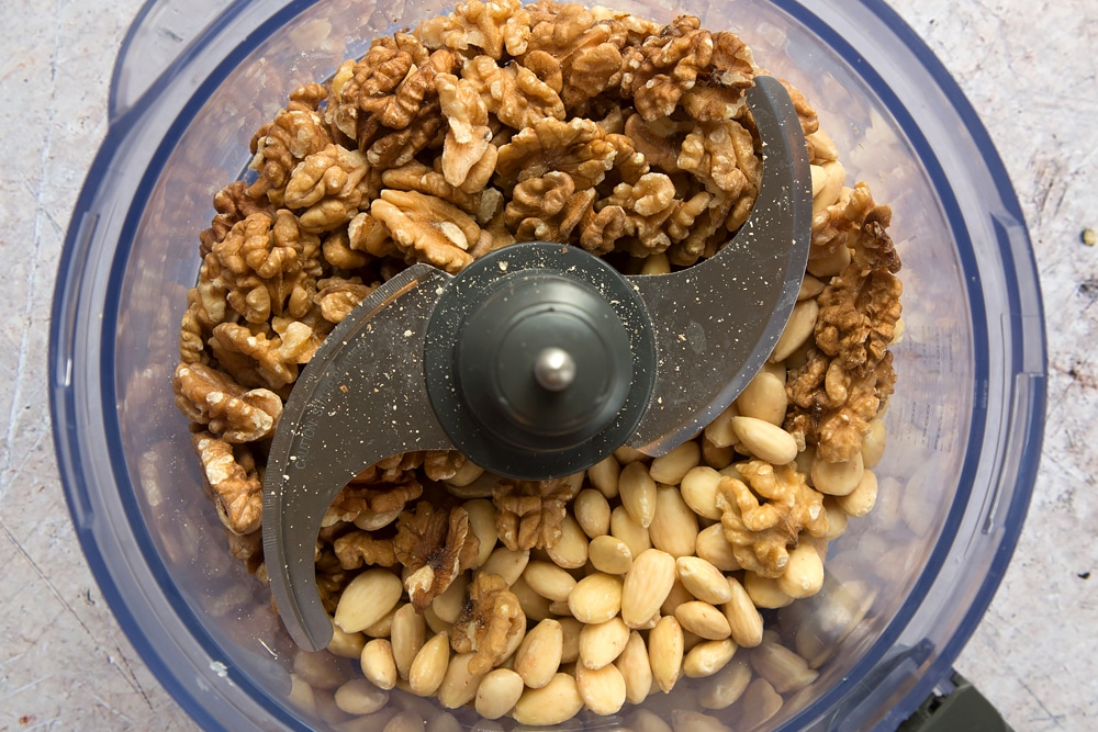 Mixed nuts, shown in a food processor