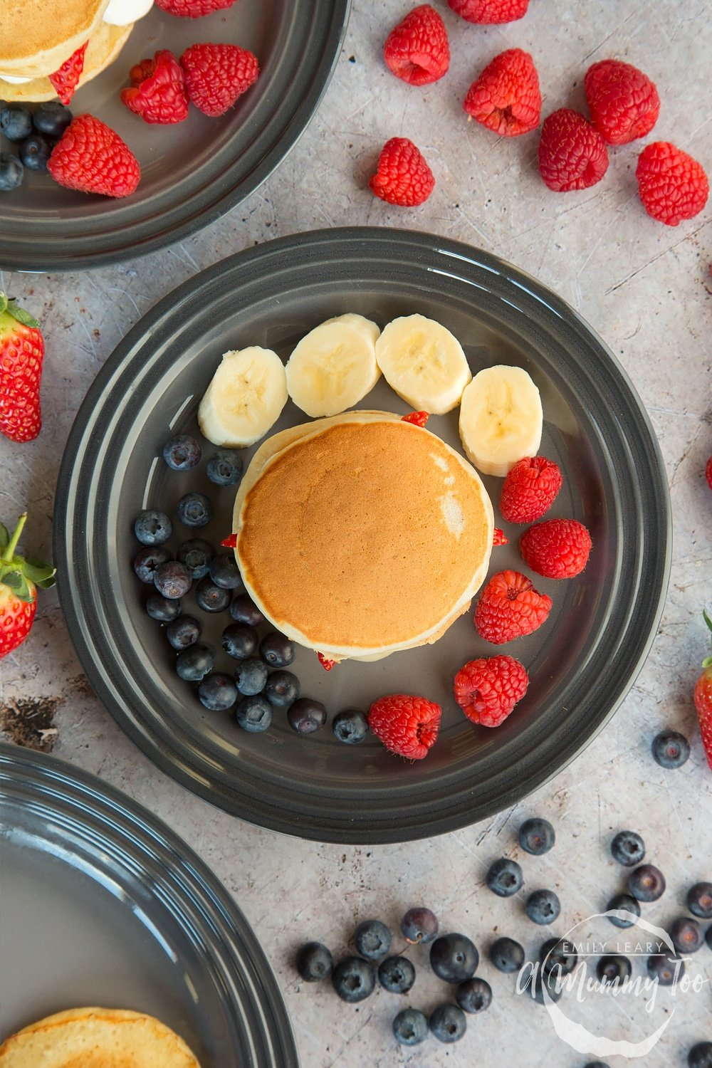 Surround your fruity pancake stack with fresh fruit and serve