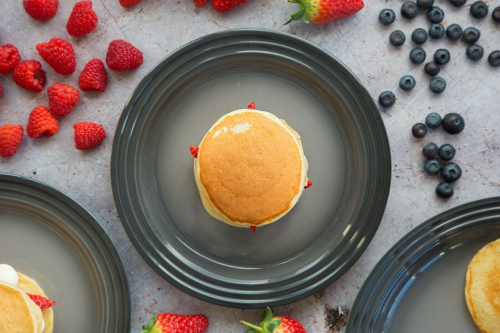 A final pancake is added to the top to create a fruity pancake stack