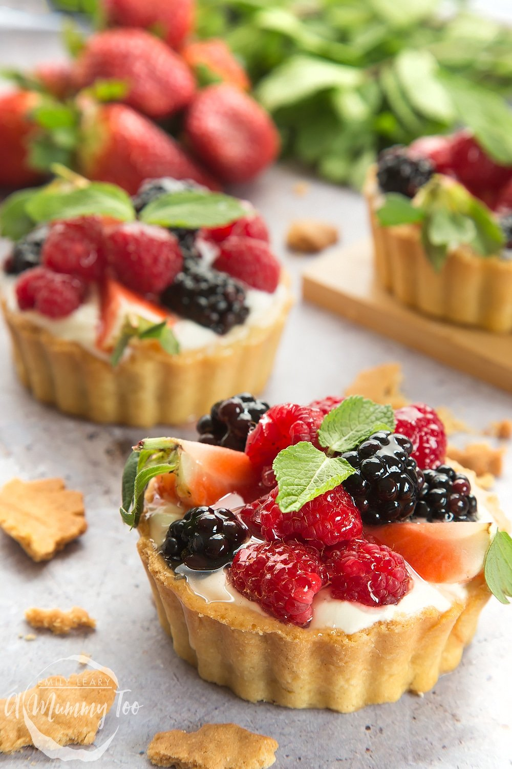 The whipped yogurt fruit tarts, shown topped with mint