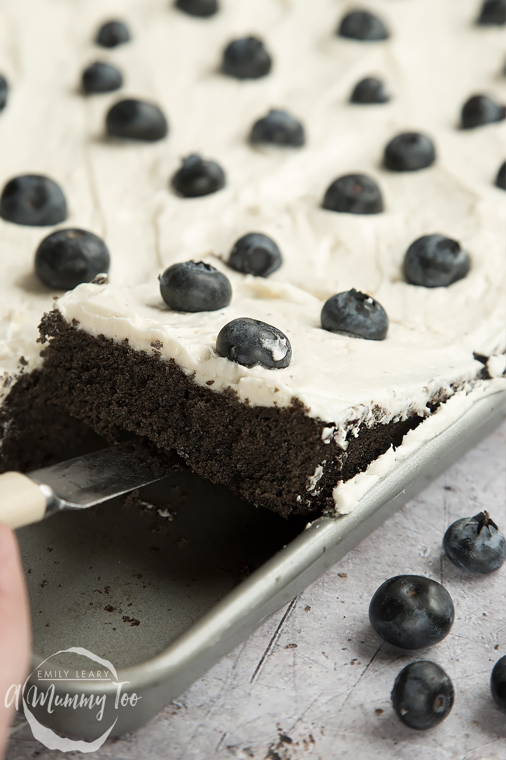 Close up of the black velvet sheet cake being served
