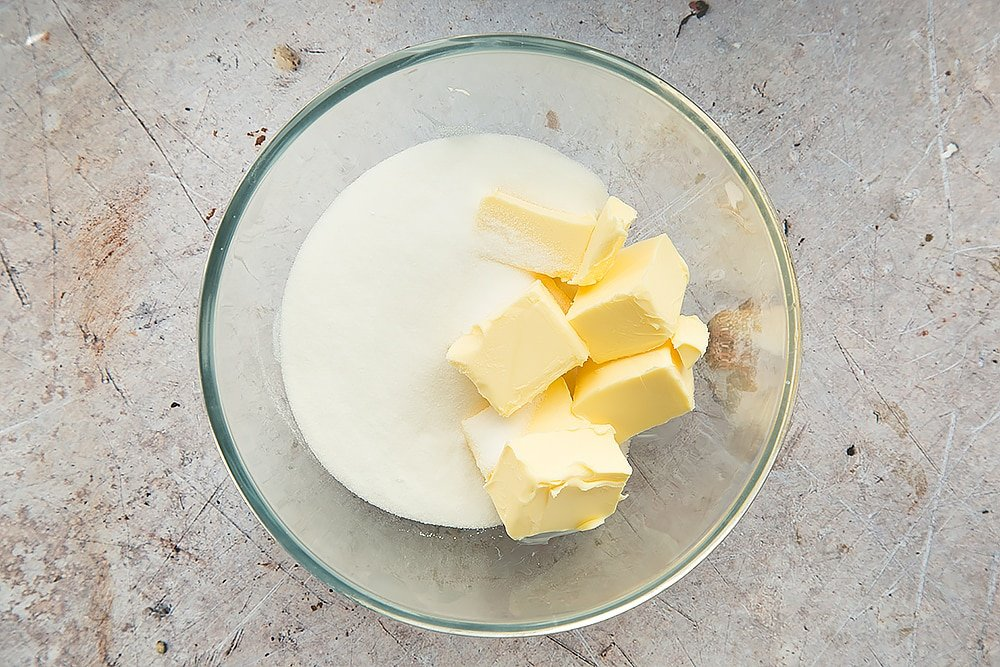 Butter and sugar, shown in a glass bowl