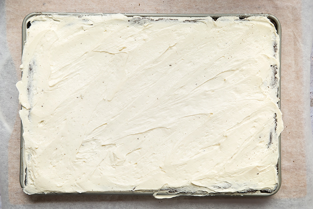 Ice your black velvet sheet cake with your classic velvet frosting