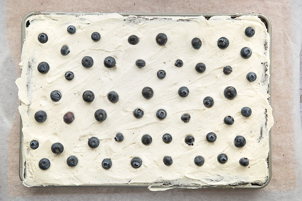 Black velvet sheet cake, topped with blueberries