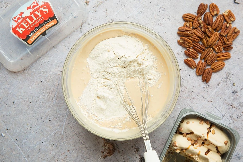 Flour is stirred into the melted butterscotch and pecan ice cream