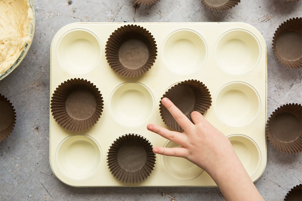 Line the muffin tray with muffin cases