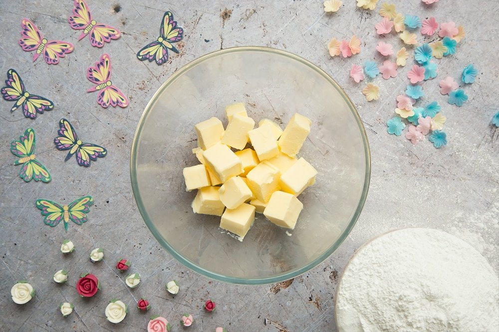 Cubed, softened butter is the first ingredient in making the delicious lemon buttercream frosting