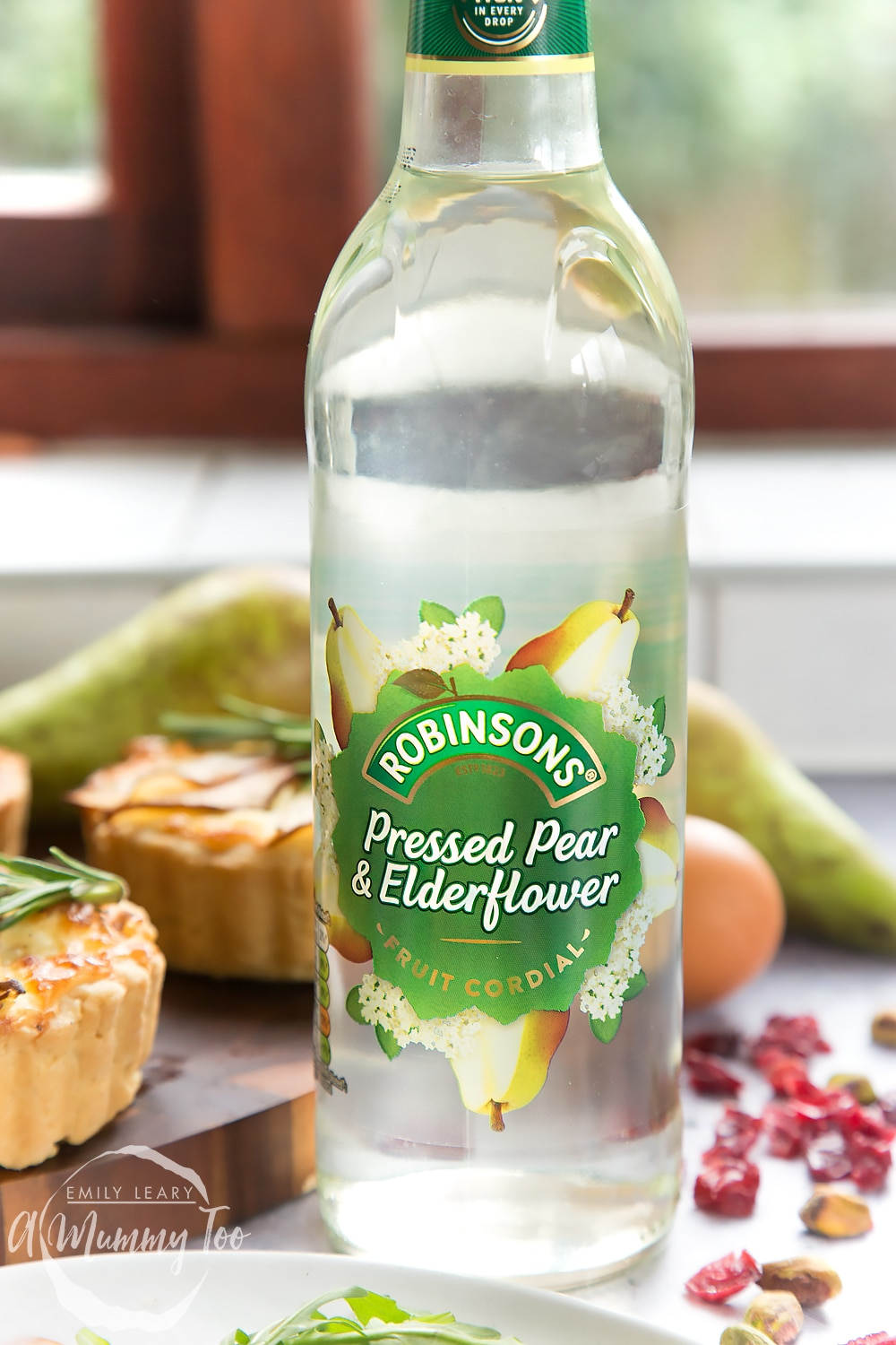 Robinsons pressed pear and elderflower fruit cordial, shown alongside the rosemary goat's cheese tarts