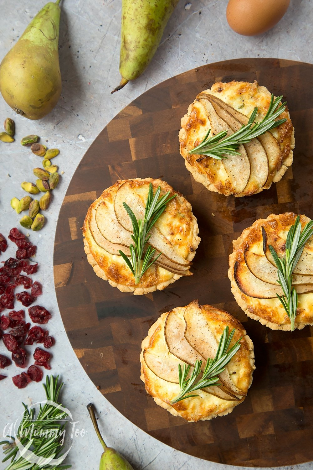Freshly baked rosemary goat's cheese tarts, ready to serve at your Summer party