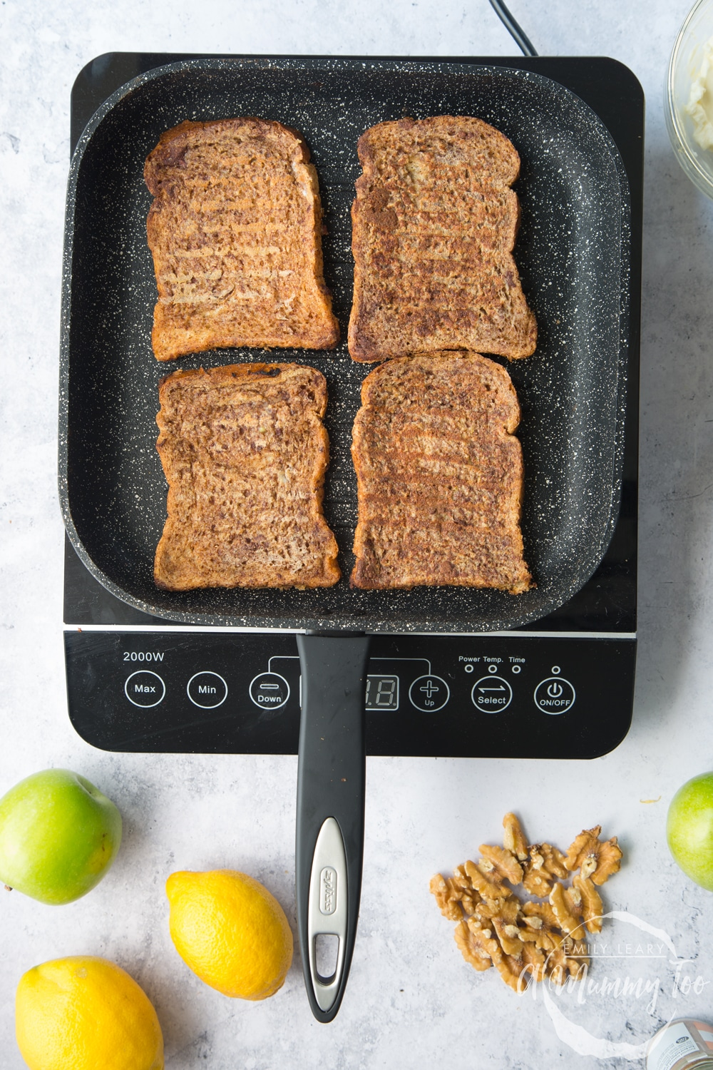 Frying cinnamon French toast in a griddle pan