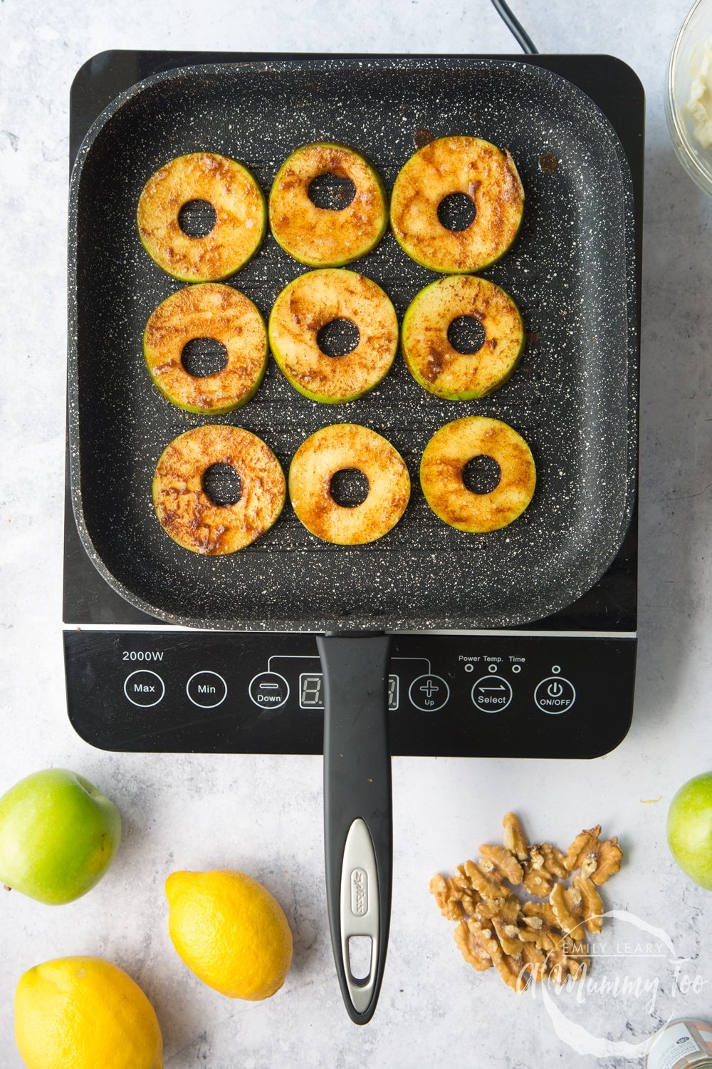 Frying the cinnamon coated apple slices in a griddle pan