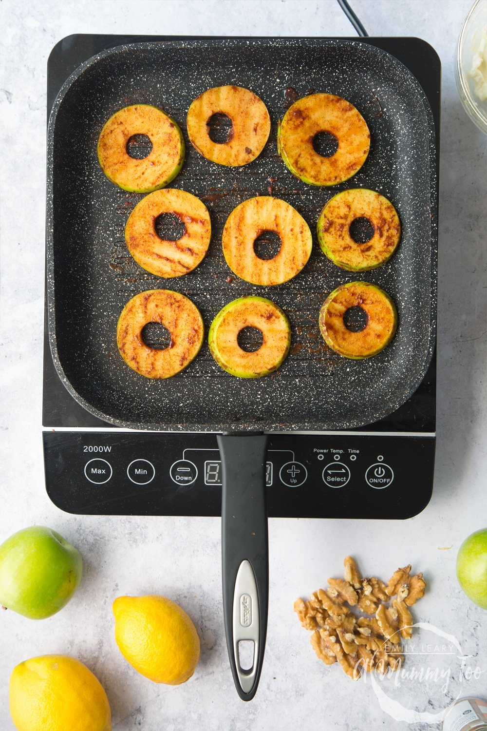Frying the cinnamon coated apple slices