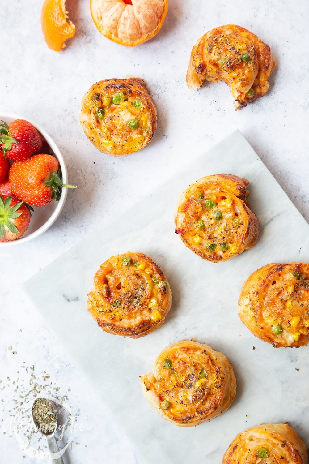 Enjoy these tasty veggie pizza roll-ups with friends and family! Served with strawberries and oranges for a lunch time snack.