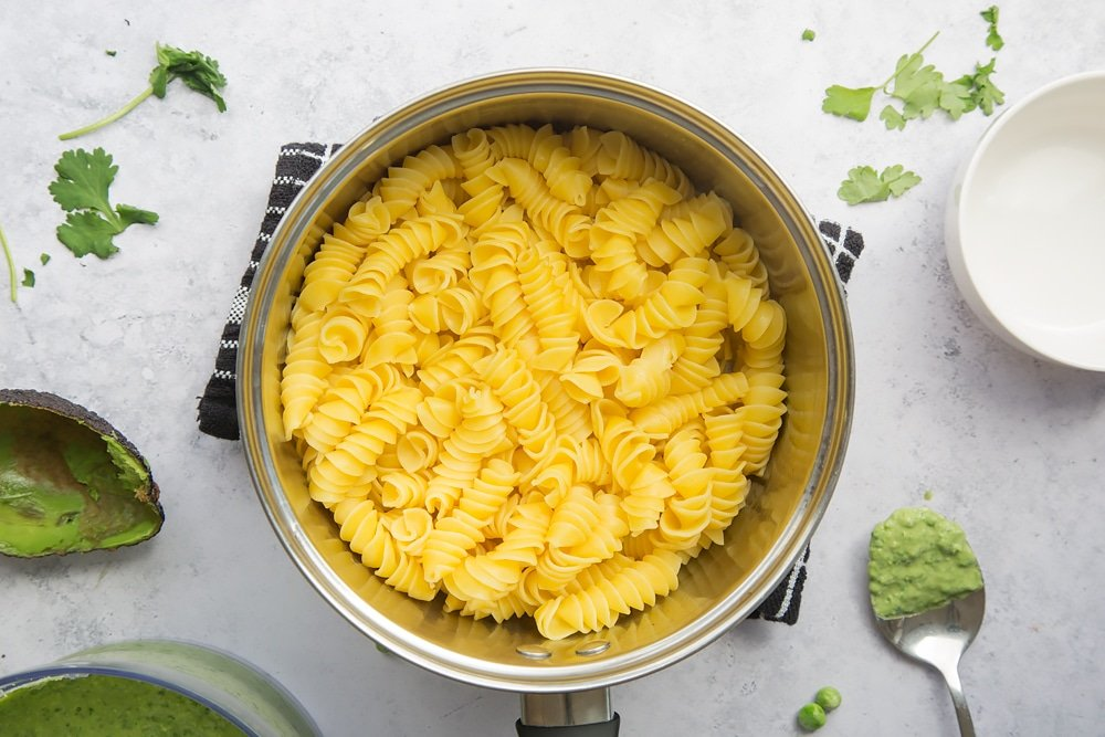 Pasta cooking in a large pan of water