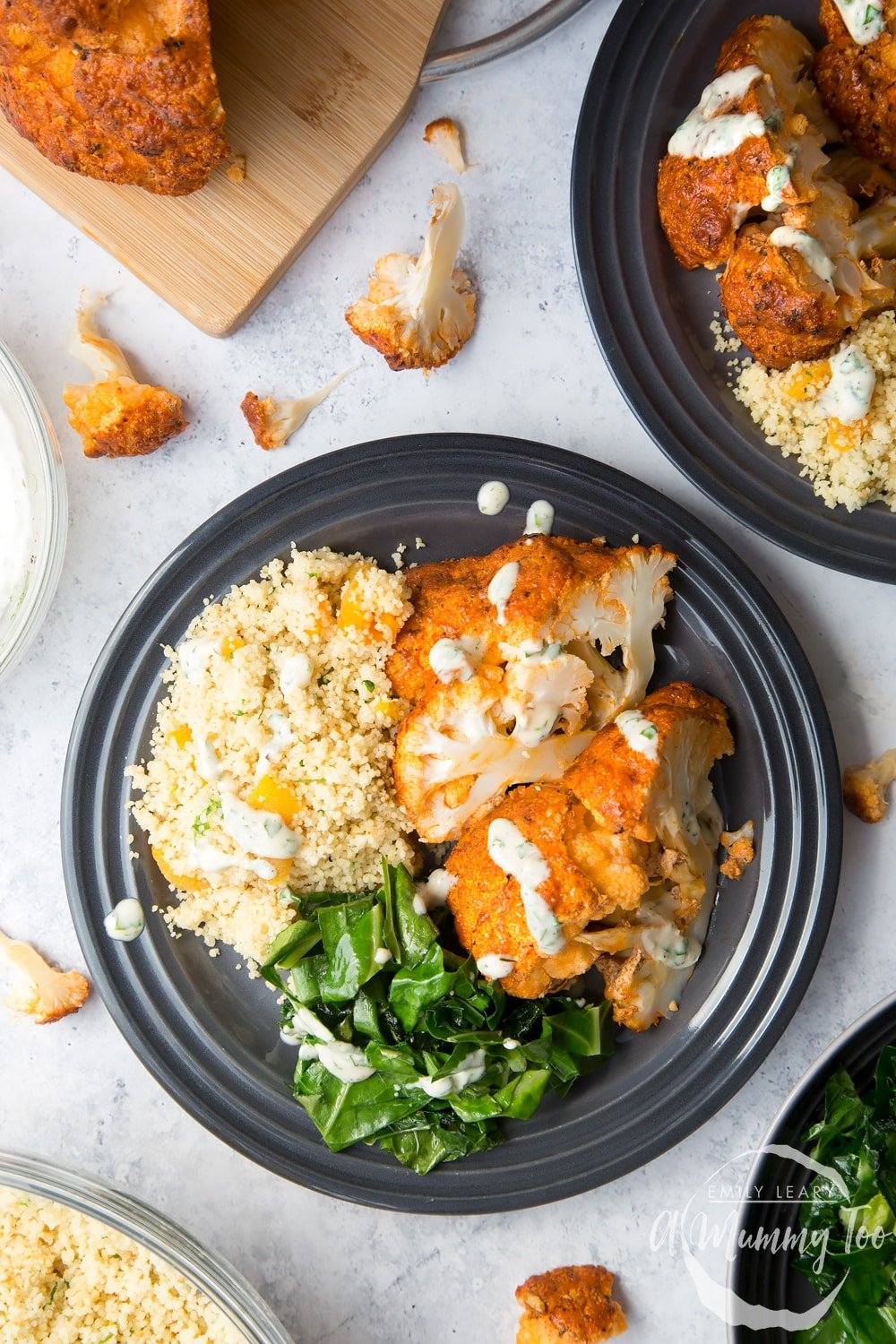 Harissa roasted cauliflower served with couscous, spring greens and drizzled with a lemon tahini sauce