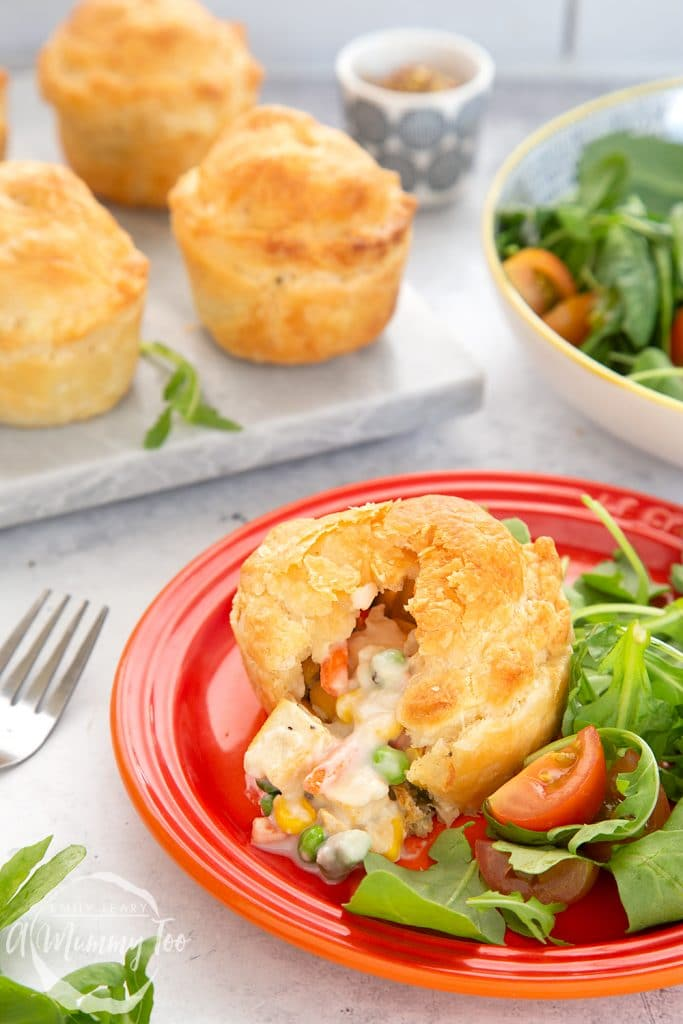 Creamy tofu and vegetable vegan mini pies served on a plate with salad