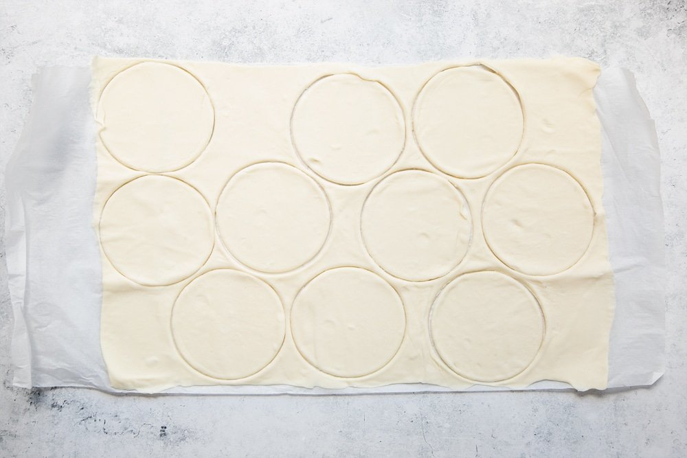 Cutting out the mini pie cases from pastry