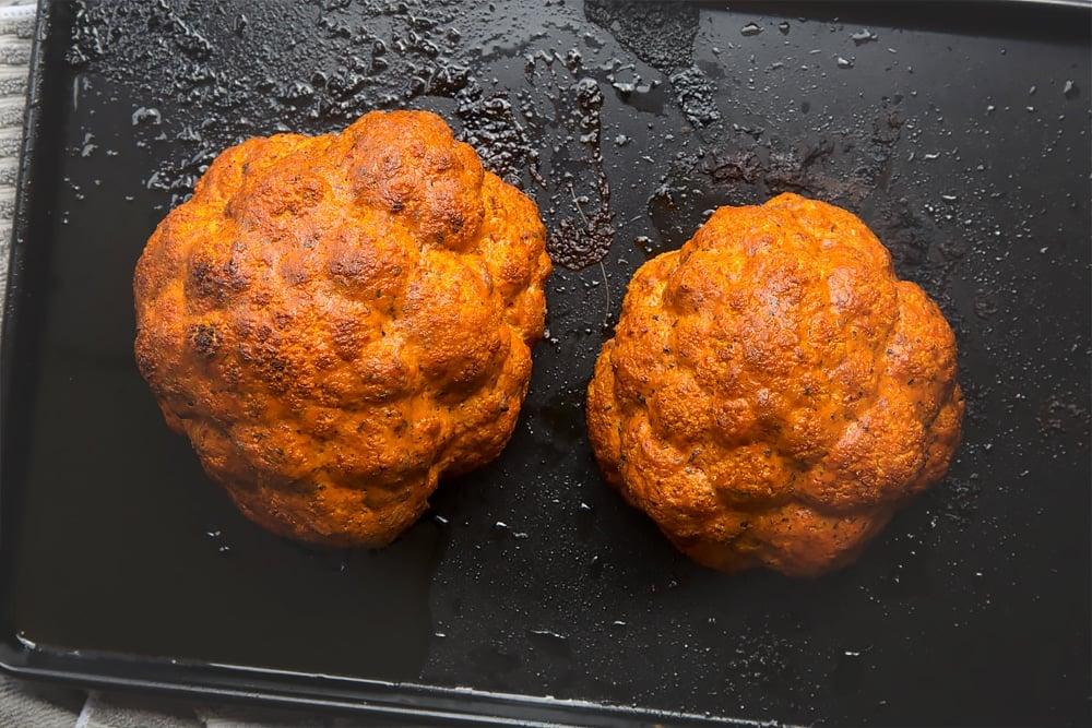 Harissa roasted cauliflowers on a baking tray