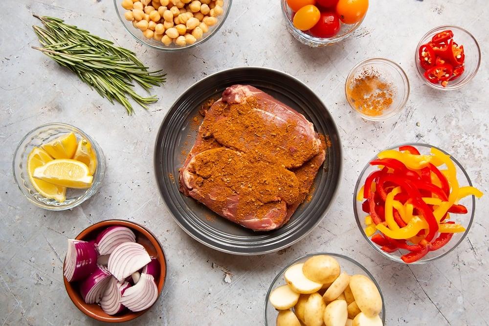 Seasoning the lamb with ras el hanout
