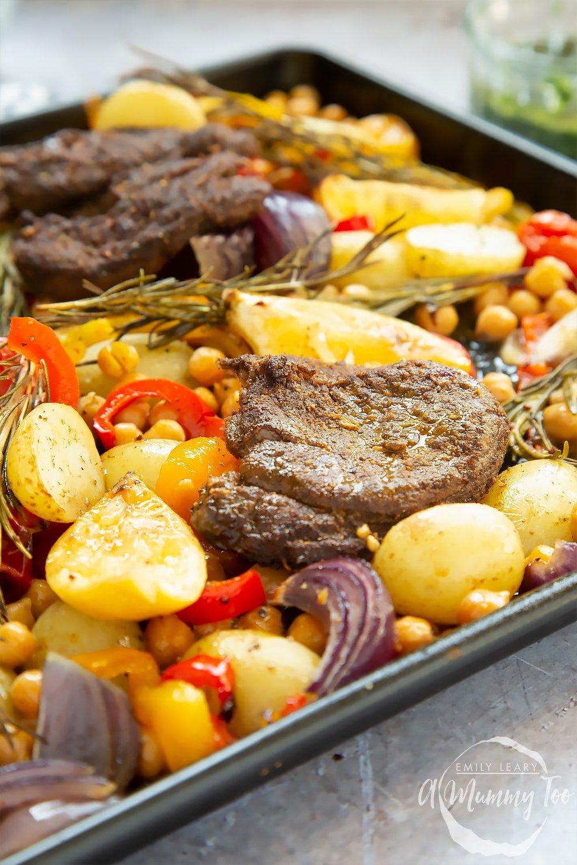 Close up of a lamb steak and veg sheet pan meal