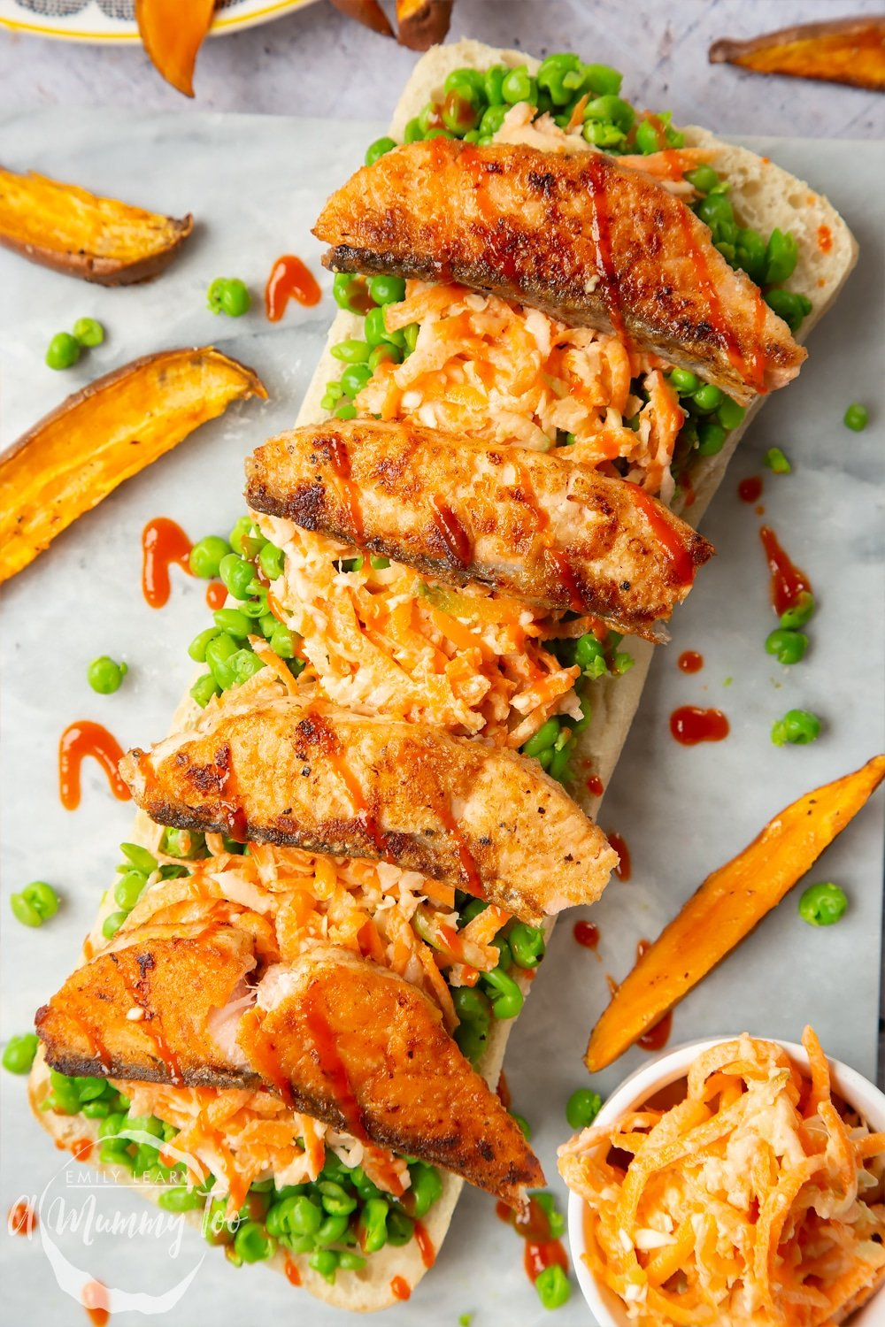 A healthier fish finger sarnie made with mushy peas, coleslaw and topped with seasoned salmon