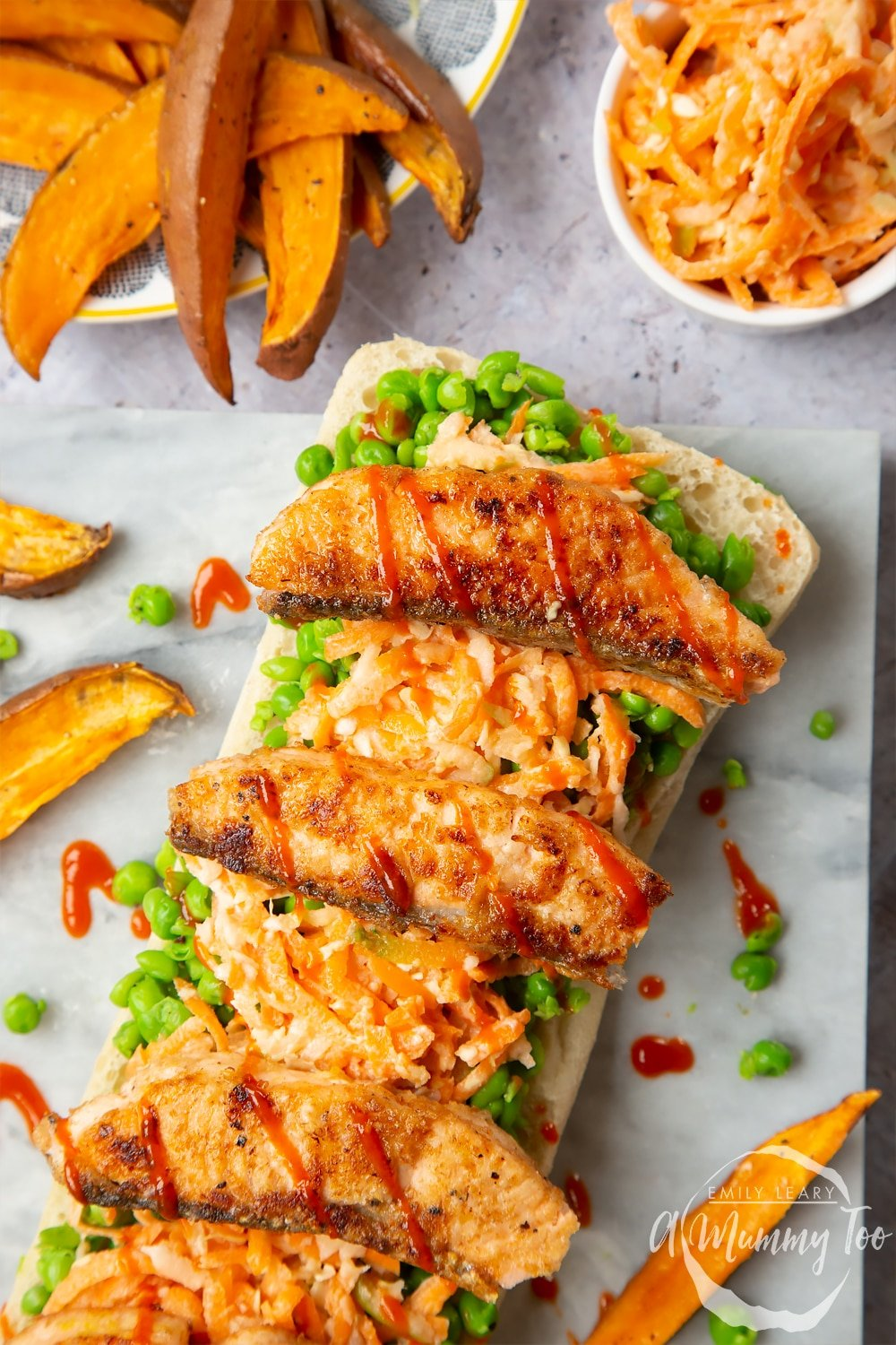 A healthier fish finger sarnie served with sweet potato wedges