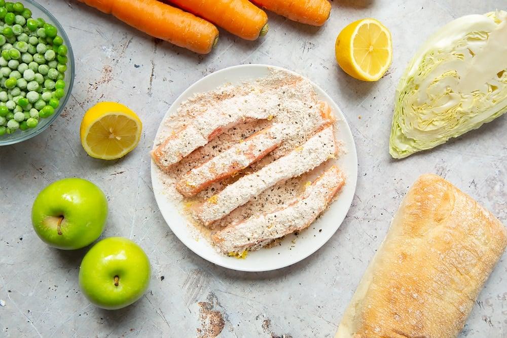 Seasoning the sliced salmon fillets