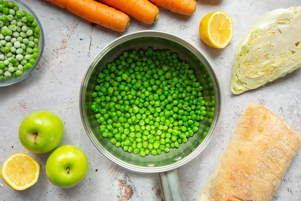 Frozen peas in a saucepan