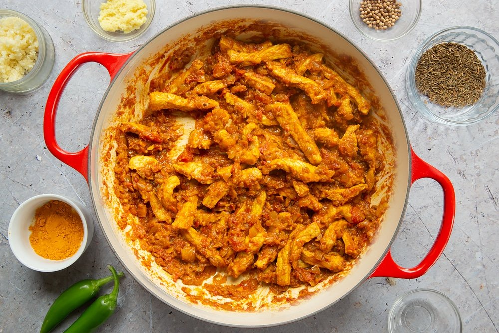 Cooking coconut-pork curry in a pan