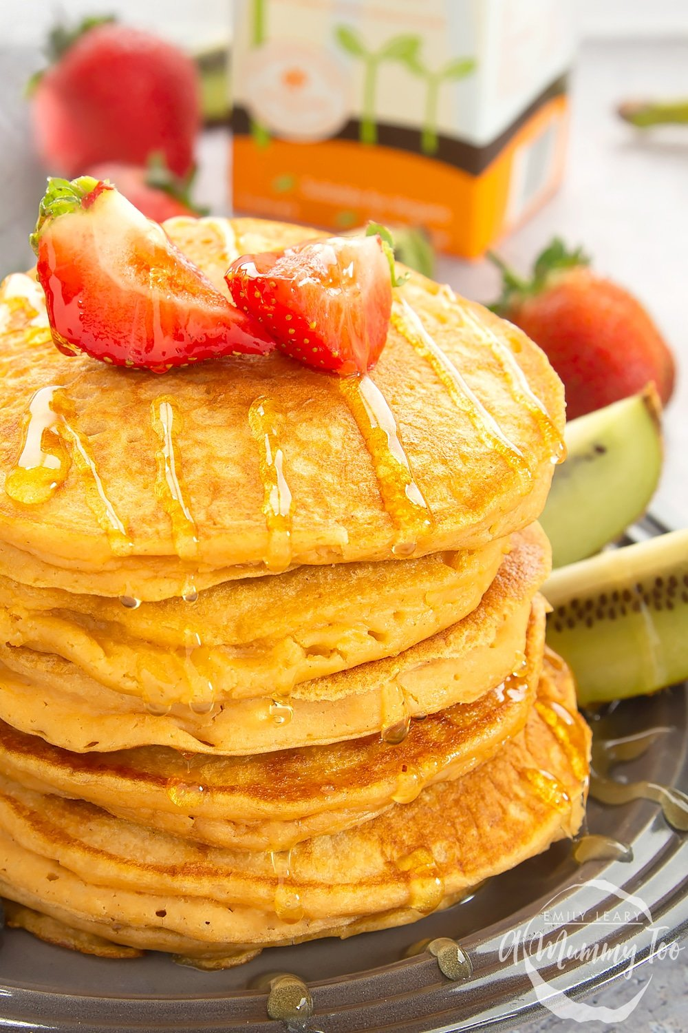 Stack of sweet potato pancakes topped with cut strawberries