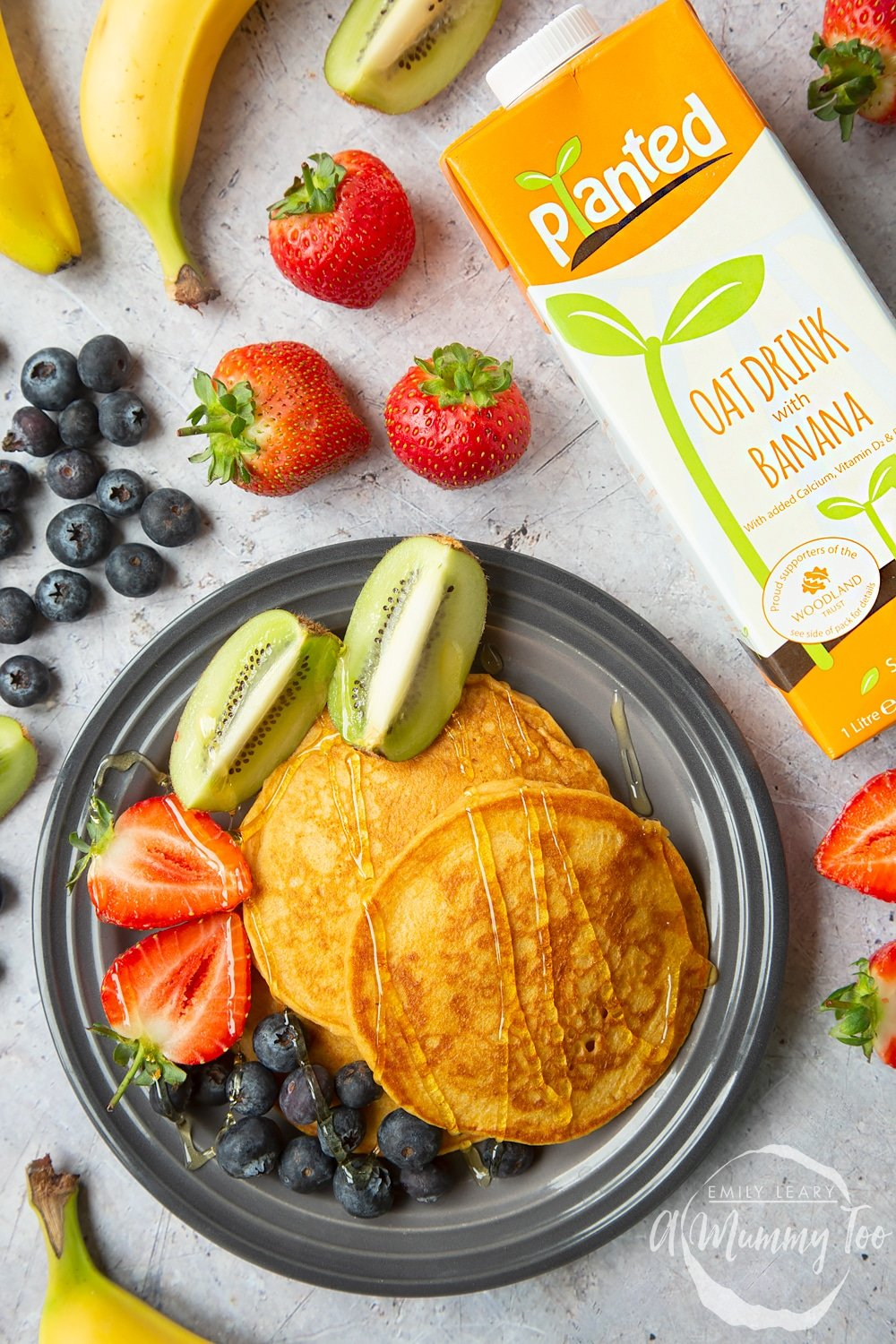 Sweet potato pancakes served with fresh fruit, made with Planted oat drink with banana