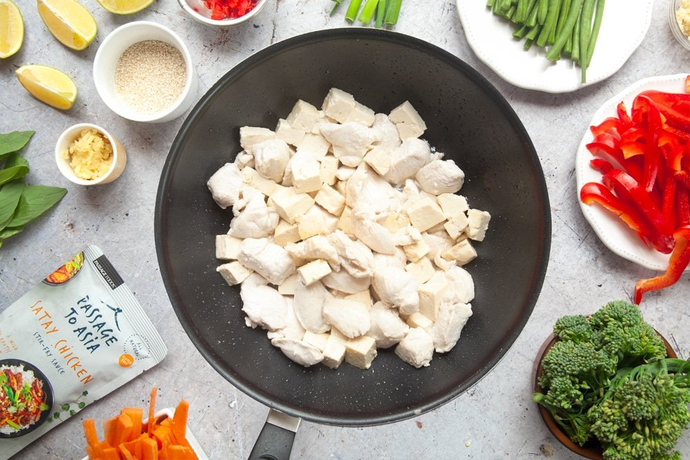 Chicken and tofu in a stir fry pan