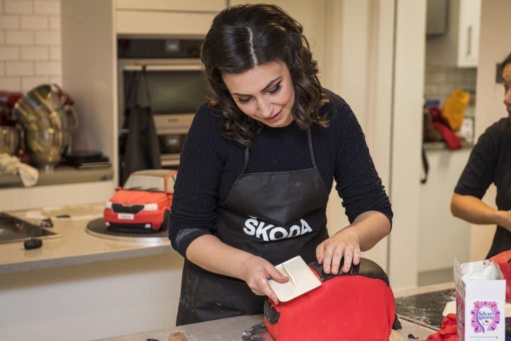 Emily Leary icing a ŠKODA Fabia cake