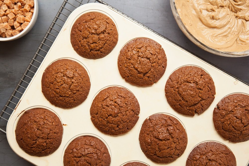 Overhead shot of muffins in a tray in a large clear bowl