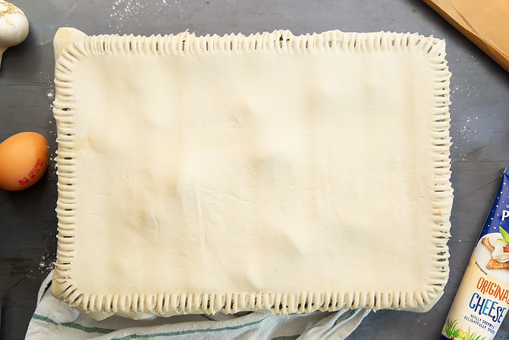 Press fork around the edges of the puff pastry to seal