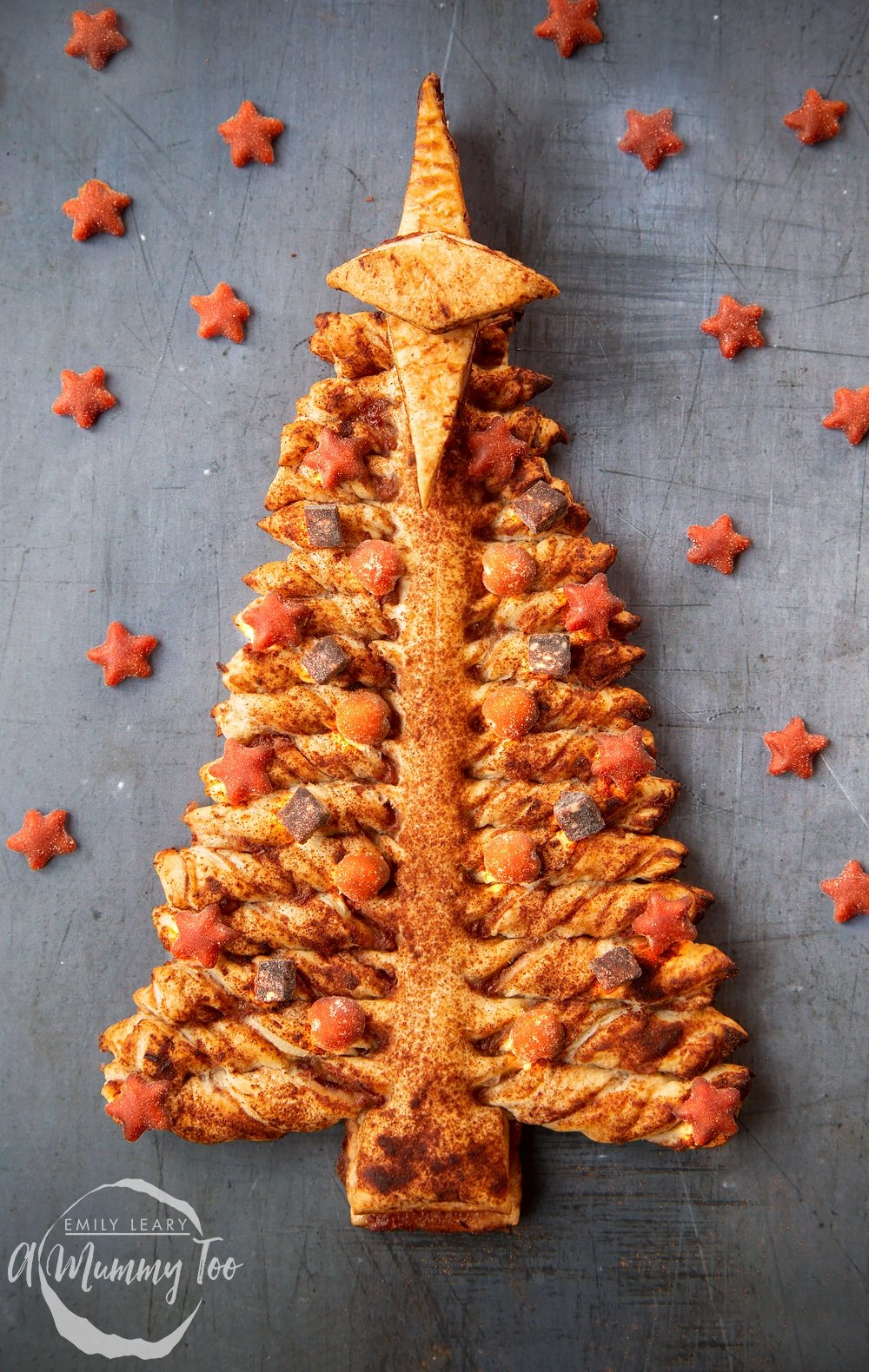 A puff pastry Christmas tree decorated with toddler-friendly snacks from Organix