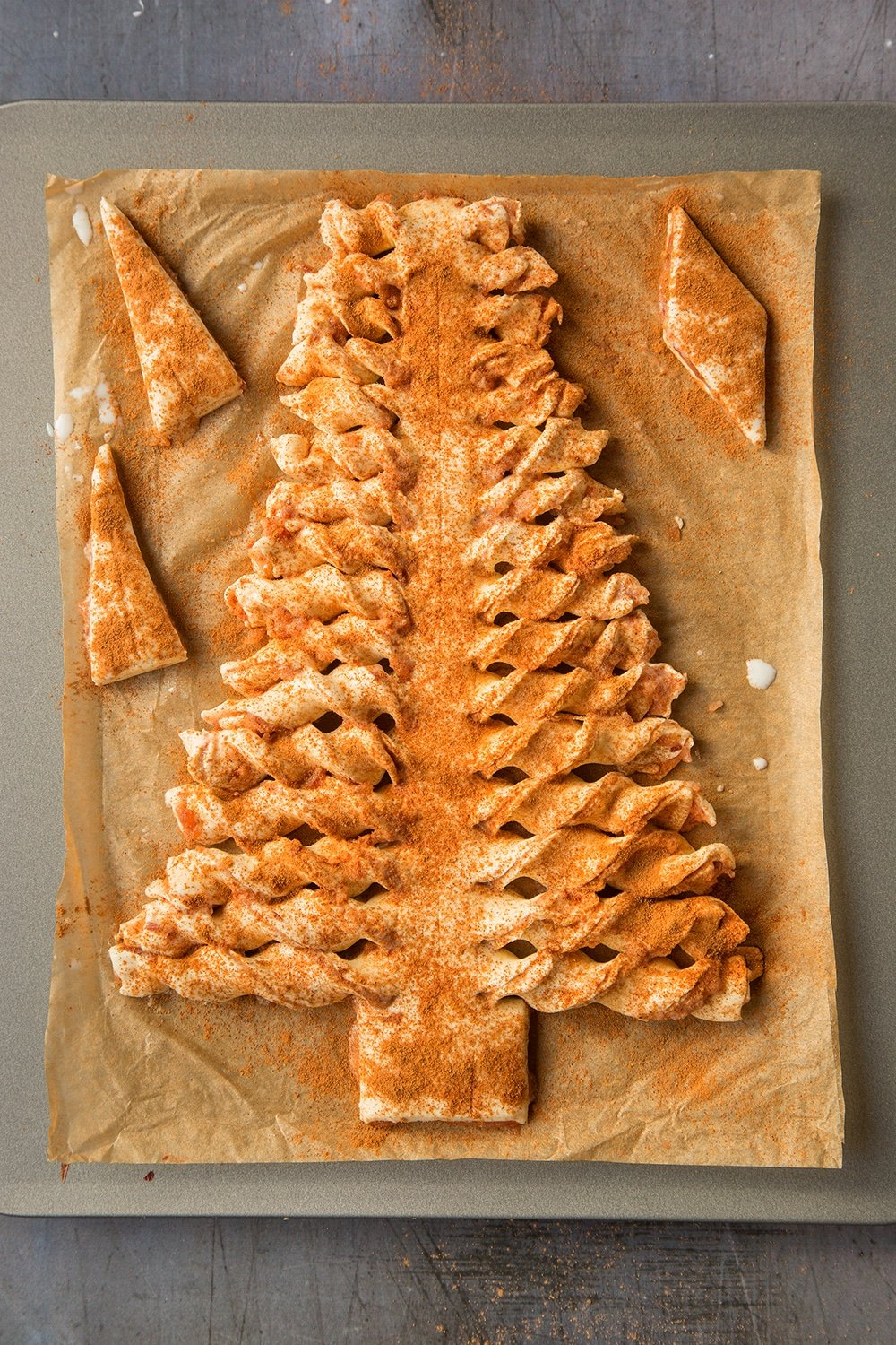 Transfer your puff pastry Christmas tree and offcuts to a baking tray