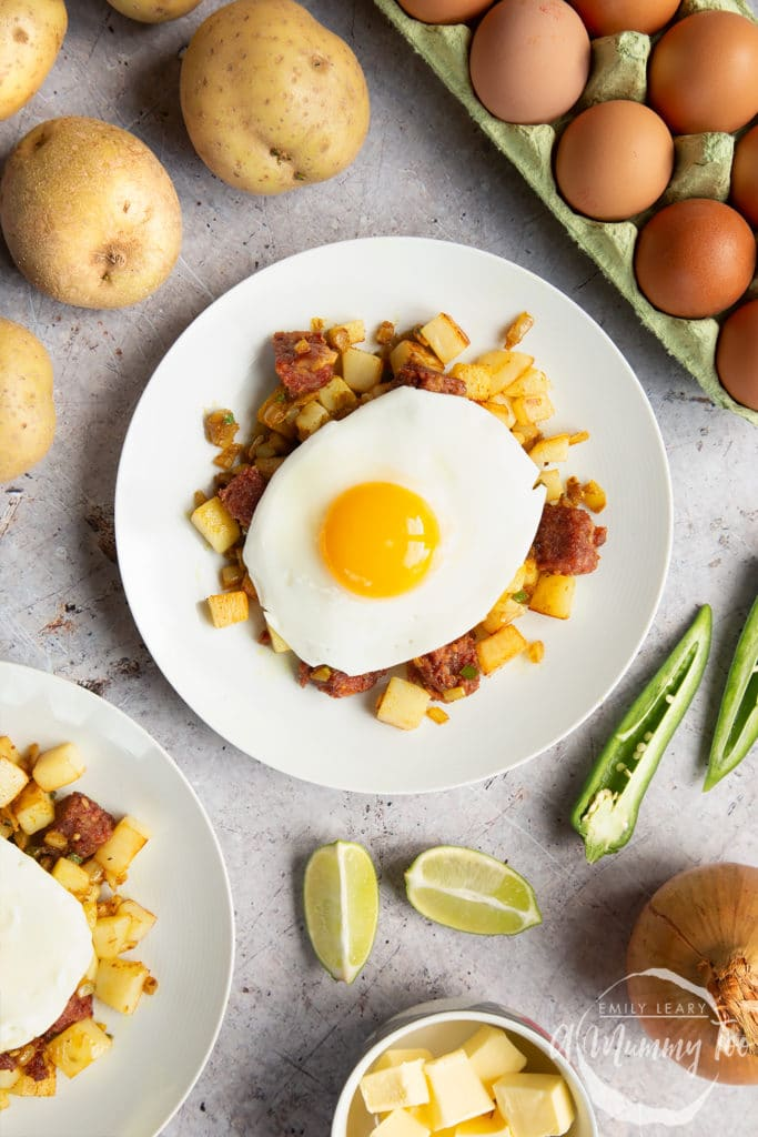 Curried corn beef hash topped with a fried egg